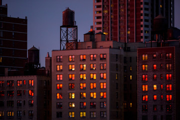 Sunset reflected in city windows