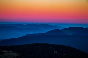 Foto op Aluminium Koraal sunset in mountains