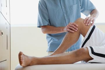chiropractor adjusting male patient