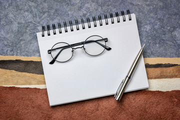 blank spiral art sketchbook with coffee