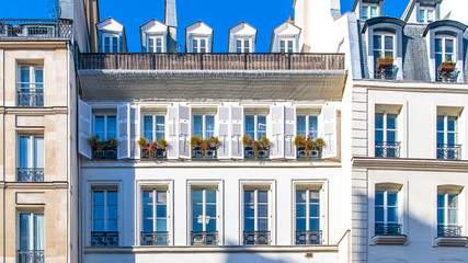 Paris, typical facade and windows, beautiful building rue Reaumur