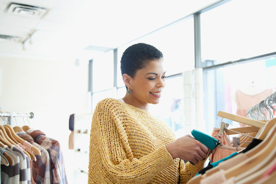 store owner adding price tags to clothes