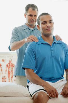 male patient receiving a chiropractic adjustment