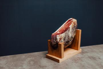 Iberian ham in a wooden ham stand
