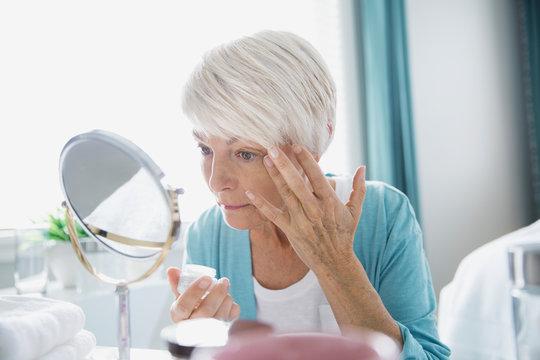Woman applying wrinkle cream