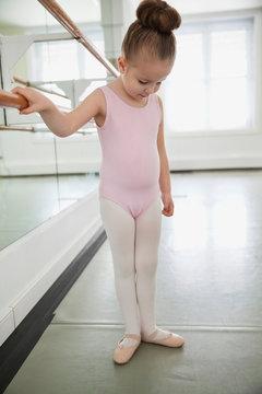Girl practicing ballet in ballet studio