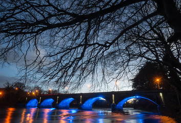 Old stone bridge illuminated up at night in the town of Listowel, County Kerry, Ireland Wall mural