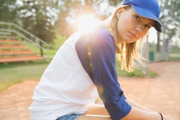 Baseball player sitting on field