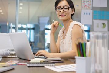 Portrait of confident businesswoman sitting at desk