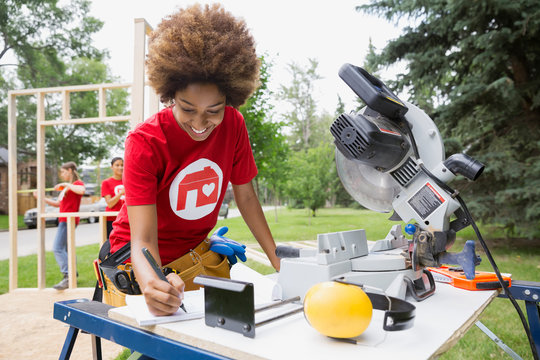 Volunteer at workbench with table saw