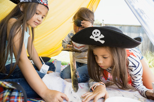 Children playing pirates and viewing treasure map