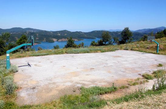 basketbal field near a lake