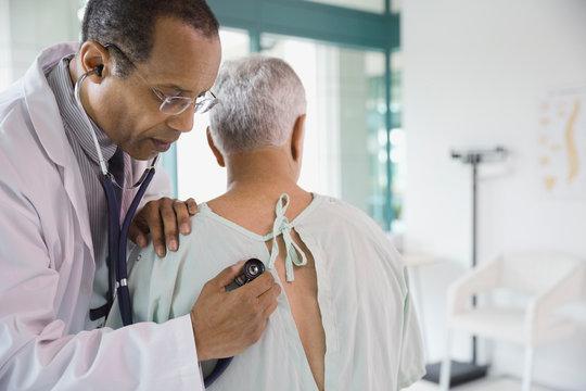 Doctor examining senior patient in hospital