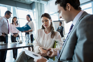 Business people reviewing data in conference room meeting