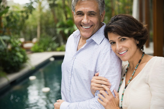 Portrait of mature couple standing outdoors