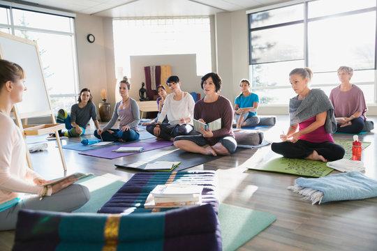 Women with journals at restorative yoga retreat