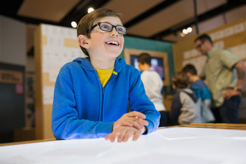 Smiling boy at light table at science center