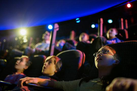 Surprised students enjoying planetarium show