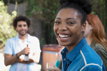Portrait smiling woman with friends on patio