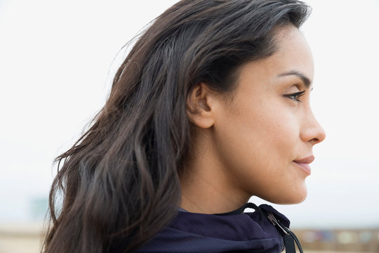 Close up pensive brunette woman looking away