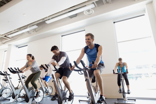 Spin class on stationary bikes at gym