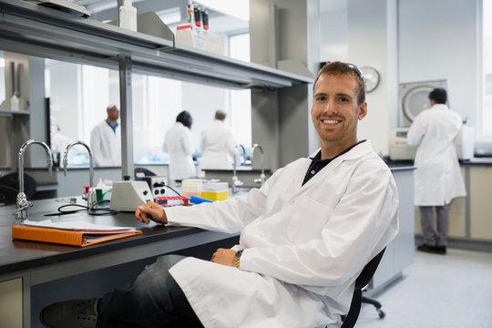 Portrait smiling scientist in laboratory