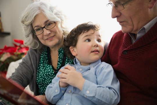 Grandson with grandparents at home during Christmas