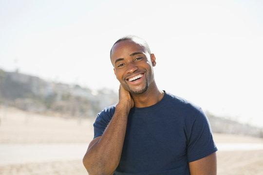 Portrait of smiling man on beach
