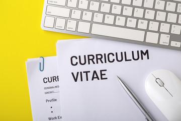 CV, curriculum vitae on yellow background