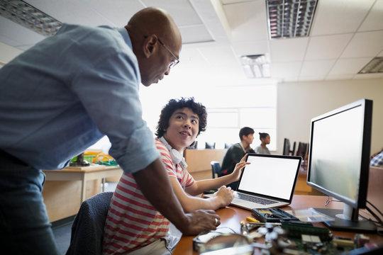 High school teacher student using laptop computer class