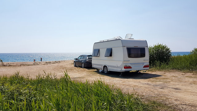 trailer caravan car by the sea, holidays in the nature outdoor by the sea