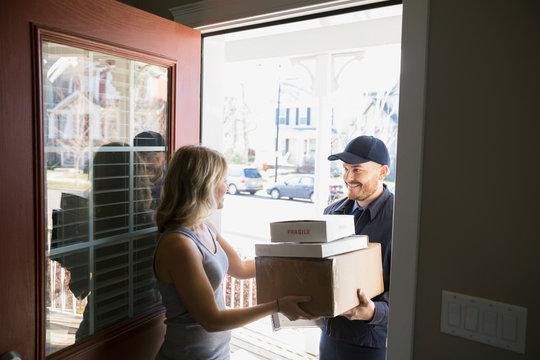 Woman receiving delivery at front door