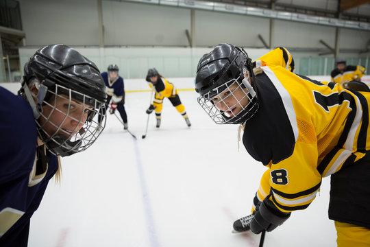 Focused womens ice hockey competitors