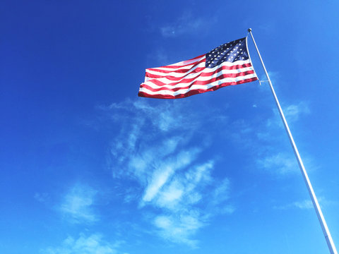 American Flag Blowing In The Wind Background with Copy Space