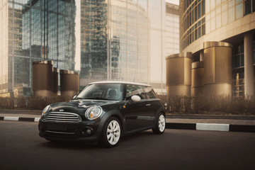 Moscow, Russia - April 27, 2019: MINI Cooper car is parked near office buildings at International Business Center Moscow-city