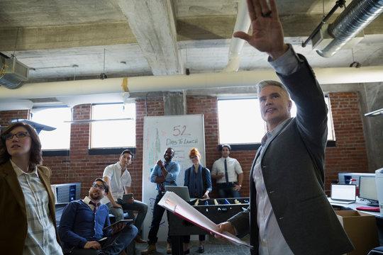 Entrepreneur leading brainstorming meeting in office