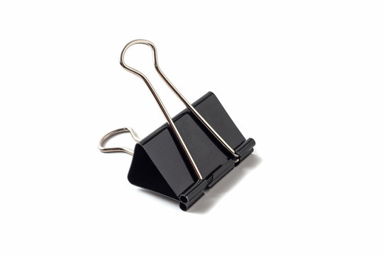 Black metal binder clip on white background isolated.