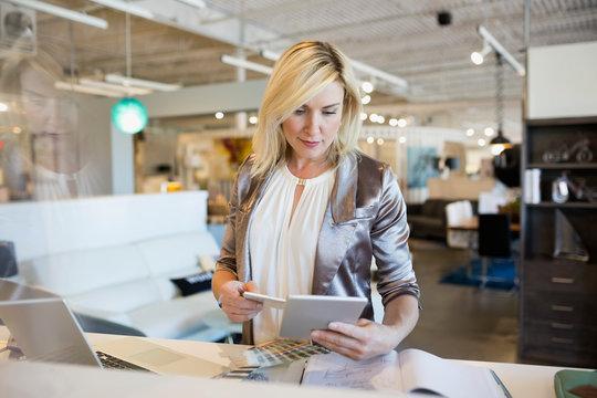 Interior designer working at digital tablet in home furnishings store