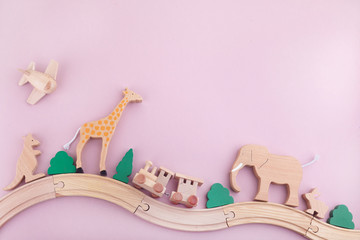 Zero waste. Eco wooden toys on pink background. Flat lay. Top view