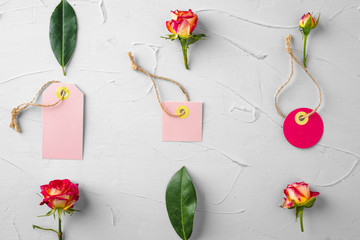 Flowers and blank paper tag. Sending flowers