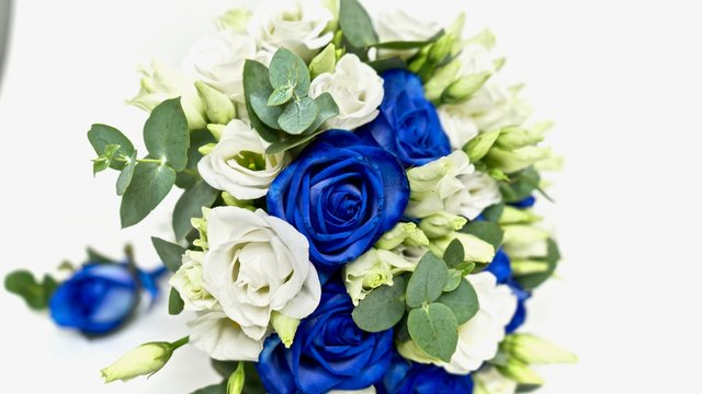 Macro wedding flower bouqet. Floral close-up. blue roses, white and green flwers on white background.