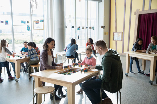 Family playing with dominoes in science center