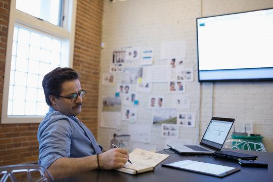 Male designer brainstorming in conference room