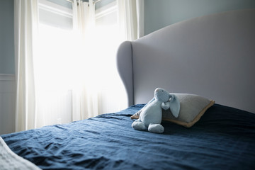Stuffed bunny rabbit on bed in child