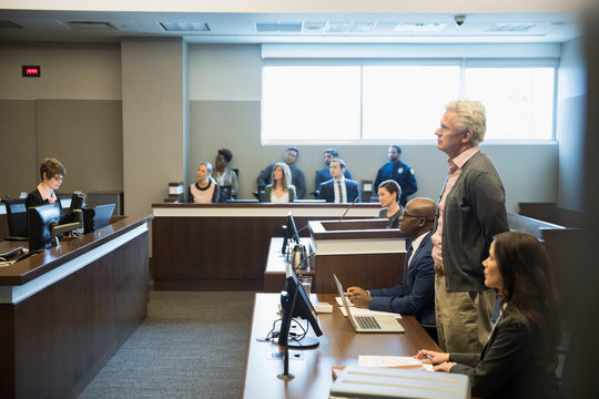 Defendant standing in legal trial courtroom