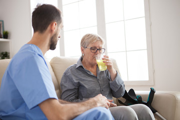 Senior woman in nursing home taking her pills