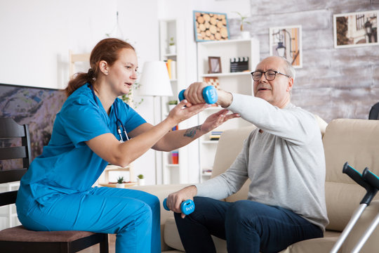 Senior man in nursing home with doing physical therapy