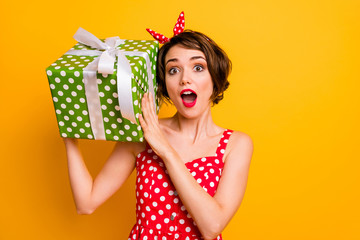 Portrait crazy astonished girl get big green dream gift box shake it want know what boyfriend give her 14-february wear vintage style clothing isolated yellow color background