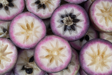 Purple star apple fruit or cainito fruits background
