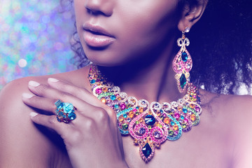 Beautiful model girl with set of Jewelry. Luxury girl in shine jewellry: Eearrings, Necklace, and...